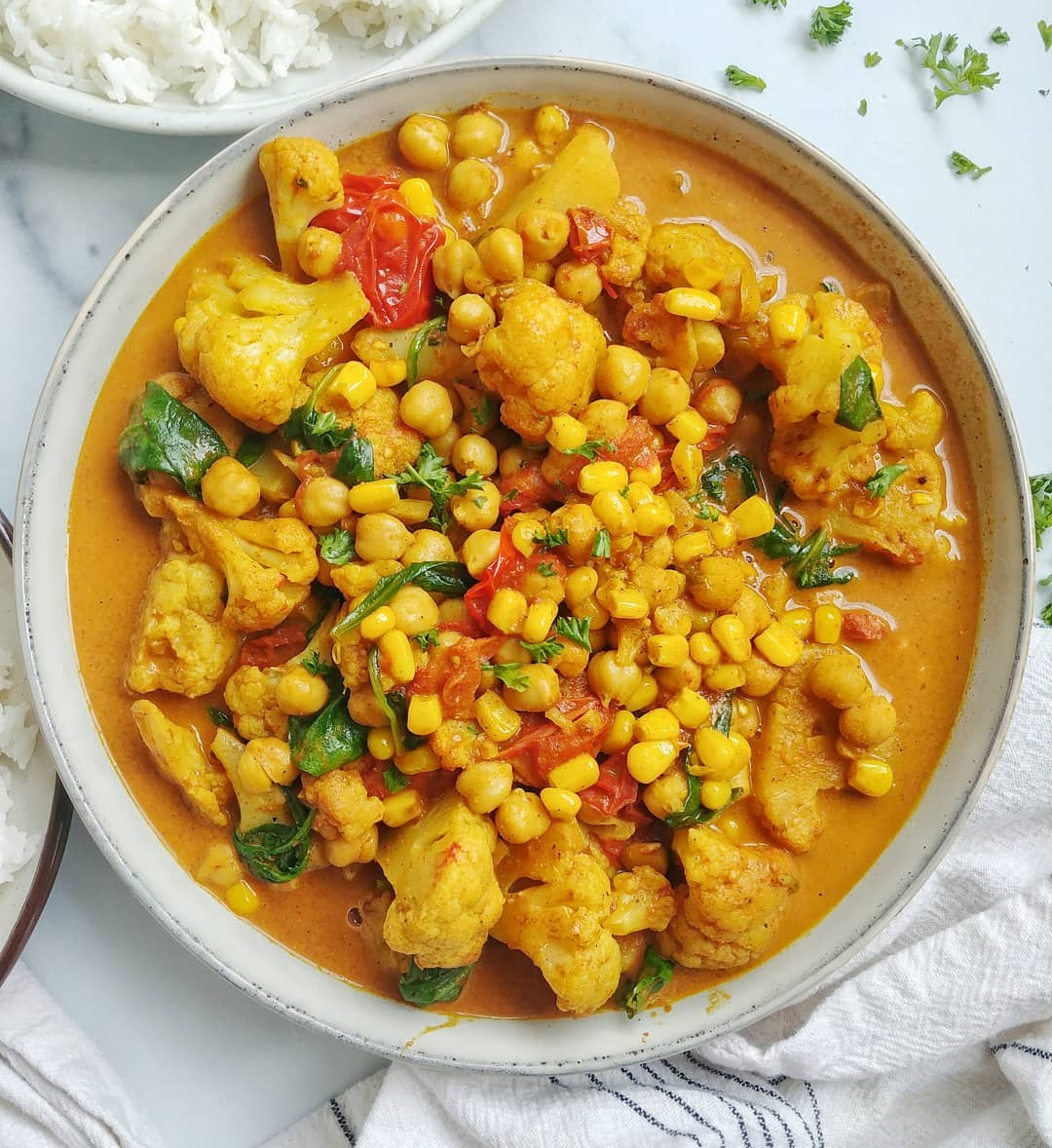 Cauliflower & Chickpea Curry with spinach, tomatoes and corn